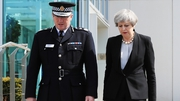 Theresa May pictured alongside GMP Chief Constable Ian Hopkins in Manchester