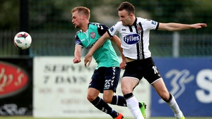 Dundalk's Robbie Benson and Lukas Schubert of Derry compete for the ball