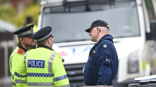 Police outside a property in Greater Manchester