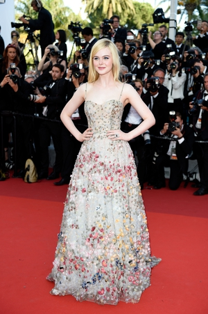 Day Seven - Tuesday May 23: The delicate flower of this year's festival! Elle Fanning wore a floral Dior gown and looked radiant.