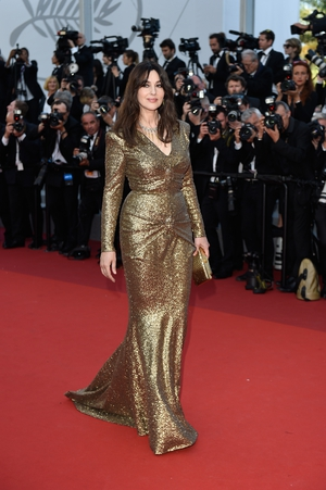 Day Seven - Tuesday May 23: The mistress of ceremony Monica Bellucci stuns in this glittering draped gown.