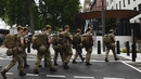 British soldiers head toward a building next to New Scotland Yard police HQ near to the Houses of Parliament in central London
