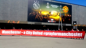Manchester United fans unveil a banner in Stockholm. Pic: Stretford End Flags on Twitter @SEF_MUFC
