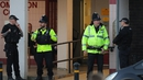Armed police stand outside a block of flats in Blackley, Greater Manchester, where a woman was arrested