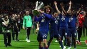 Marouane Fellaini of Manchester United celebrates with the Europa League trophy