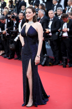 Day Seven - Tuesday May 23: Marion Cotillard shines in this custom made Armani Prive split front gown.