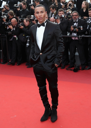 Day Eight - Wednesday May 24: French Fashion designer and Balmain creative director Olivier Rousteing is so elegant in this tuxedo twisted with low boots!