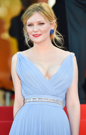 Day Eight - Wednesday May 24: Kirsten Dunst is a stunning beauty in this pale blue dress with a waist chain belt. We love absolutely everything in her style!