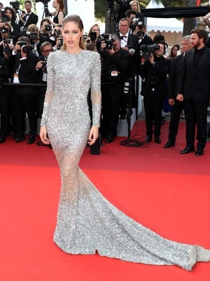Day Eight - Wednesday May 24: Model Doutzen Kroes is a stellar beauty in this Balmain gown and slicked back hair.