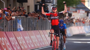 Tejay Van Garderen crosses the line for his first Grand Tour stage win