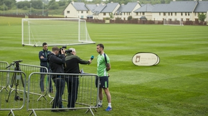 Long is interviewed by RTÉ's Tony O'Donoghue in Cork