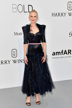 Day Nine - Thursday May 25: Nicole Kidman is all feathers and sequins in this Chanel dress with dramatic shoulders. We love her hairbun.