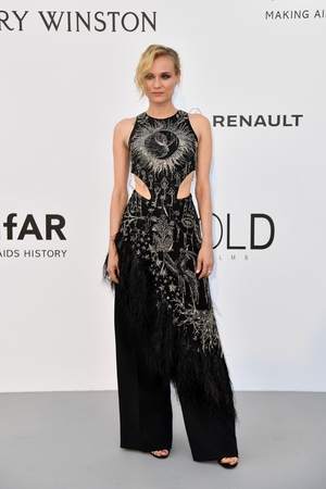 Day Nine - Thursday May 25: Diane Kruger is always original. She wore an Alexander McQueen embroidered tunic and black trousers for the amFAR gala.