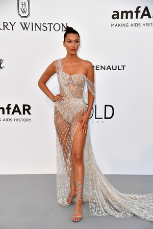 Day Nine - Thursday May 25: Bella Hadid led the amFAR gala in this stunning number. She was out of this world in this sheer embellished Rene Caovilla gown.
