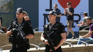 Armed police maintain a visible presence on Manchester's streets