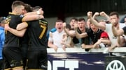 David McMillan celebrates with team-mates