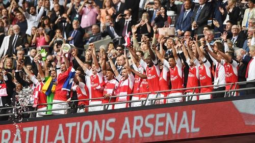 Per Mertesacker lifts the FA Cup at Wembley