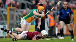 Westmeath's Killian Doyle feel the full force of Offaly's Sean Gardiner