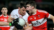 Matthew Donnelly of Tyrone and Neil Forester of Derry tangle in last January's McKenna Cup clash