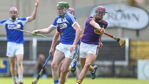 Patrick Purcell of Laois battles Wexford's Paul Morris