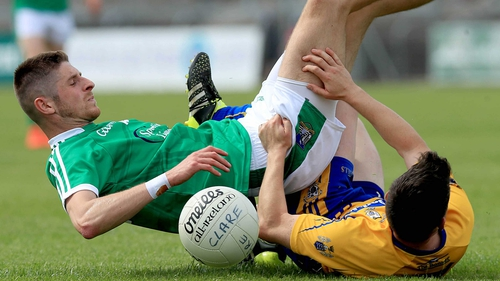 Clare's Martin McMahon with Danny Neville of Limerick get in a tangle
