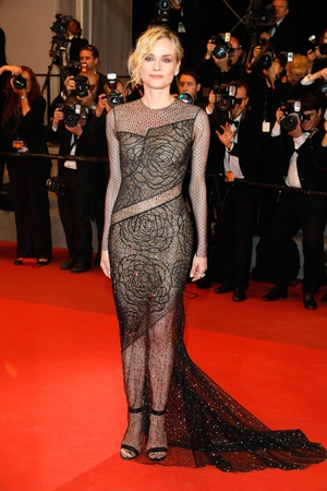 Day Ten - Friday May 26:  Diane Kruger dazzles in this Jason Wu sheer dress.
