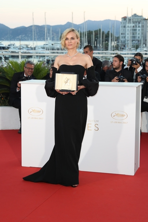 Closing Ceremony Sunday May 28: Diane Kruger stylish in custom Jonathan Simkhai to accept her prize for the Best performance by an actress in the movie 'In The Fade'.