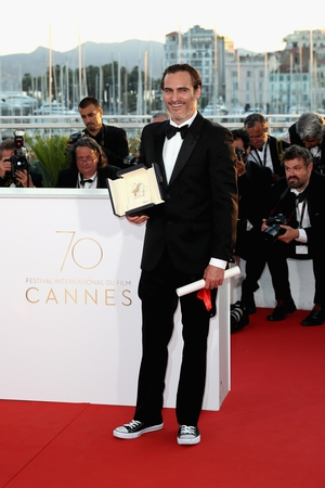 Closing Ceremony Sunday May 28: Joaquin Phoenix is the coolest wearing sneakers and a tuxedo to receive his prize for the Best performance by an actor for his role in 'You Were Never Really Here'.