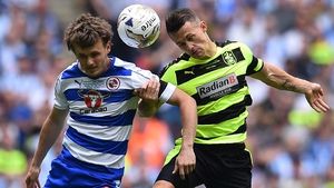 John Swift of Reading and Jonathan Hogg of Huddersfield rise for a header