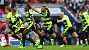 We're there! - Huddersfield players erupt after Christopher Schindler's decisive penalty kick