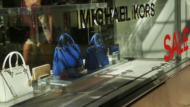 Michael Kors buys shoemaker Jimmy Choo
