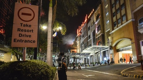 Witnesses report gunshots, explosions at hotel-casino in Philippines