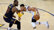 LeBron James in action against Stephen Curry