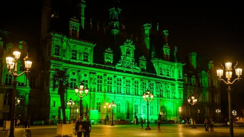 Paris City Hall illuminated in green in response to Donald Trump's move