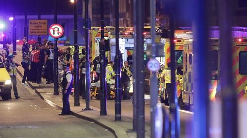 Emergency personnel at the scene on London Bridge last night
