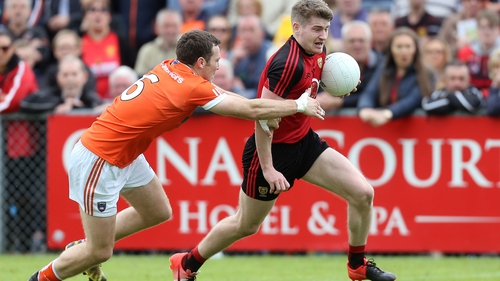 Conor Maginn gets away from Brendan Donaghy