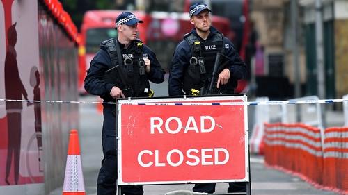 Armed police guard a closed road near Borough Market