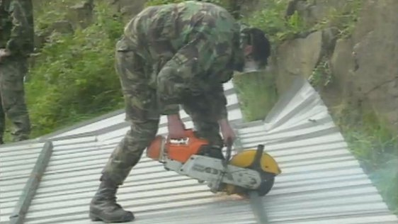 Soldier dismantles checkpoint