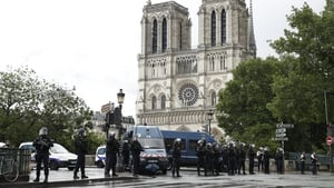 Police install a security parameter outside of Notre Dame cathedral after the attack