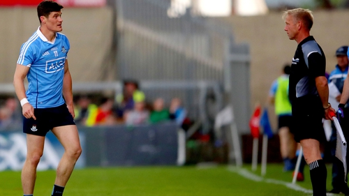 Diarmuid Connolly speaks to linesman Ciarán Branagan during the defeat of Carlow