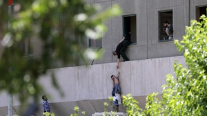 A child is rescued from the Parliament building in Tehran