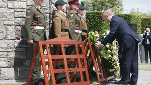 Taoiseach Enda Kenny laid a wreath at the foot of the Round Tower memorial