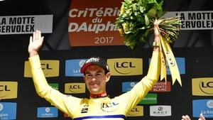 Richie Porte celebrates claiming the yellow jersey