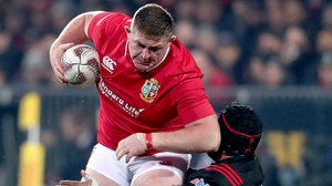 Tadhg Furlong crashes though a tackle from Jordan Taufua of the Crusaders
