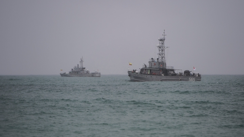 Myanmar navy ships battled high winds as the search for the wreckage of the military plane continued