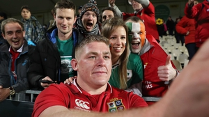 Tadgh Furlong poses for a selfie with fans