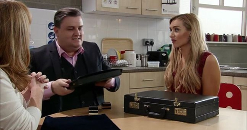 Simon charms the ladies with his wares on Corrie