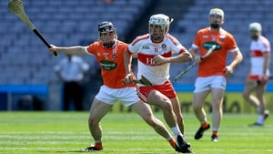 Armagh's John Corvan tries to dispossess Derry forward Mehaul McGrath