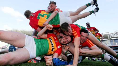 Elated Carlow players celebrate their triumph