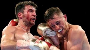 Ryan Burnett (R) in action against Lee Haskins